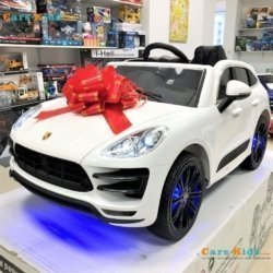 Электромобиль Porsche Cayenne SX1688 белый (легкосъемный аккумулятор, колеса резина, кресло кожа, пульт, музыка)